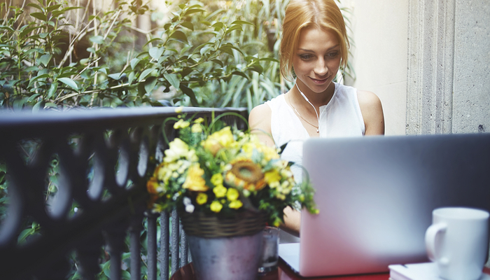 Online subscription services - woman with laptop