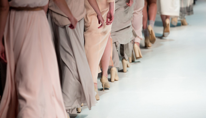 Runway Image of Women in Pink and Gray Pastel Dresses