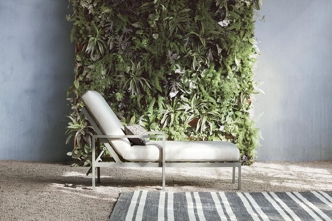 Arhaus Folding Chair Beauty Shot with Foliage Backdrop