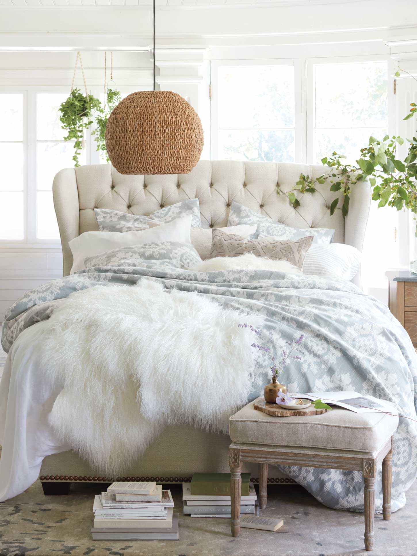 Arhaus Bed with Layers of Blankets
