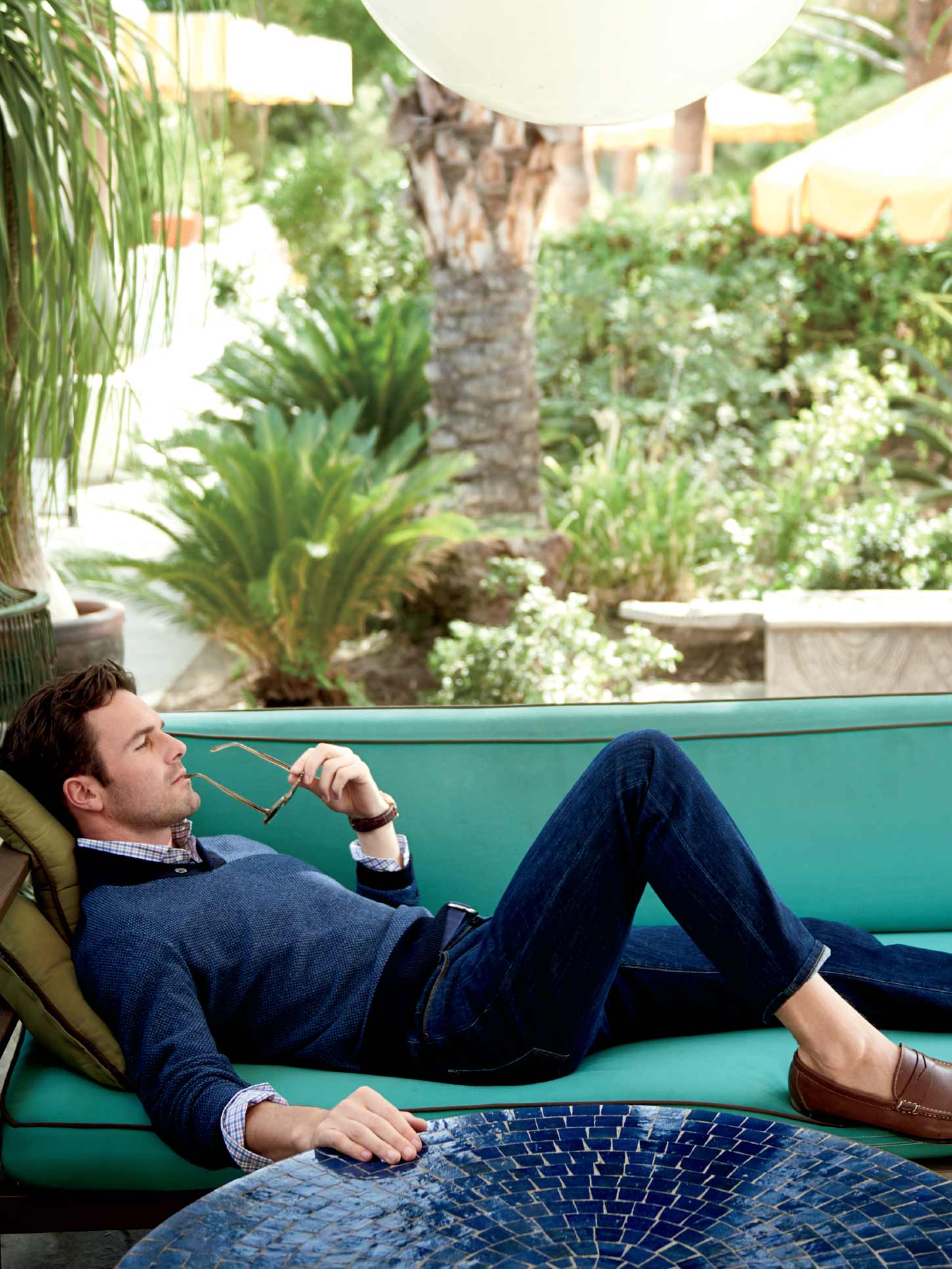 Peter Millar Image of Model Laying on Couch Outside