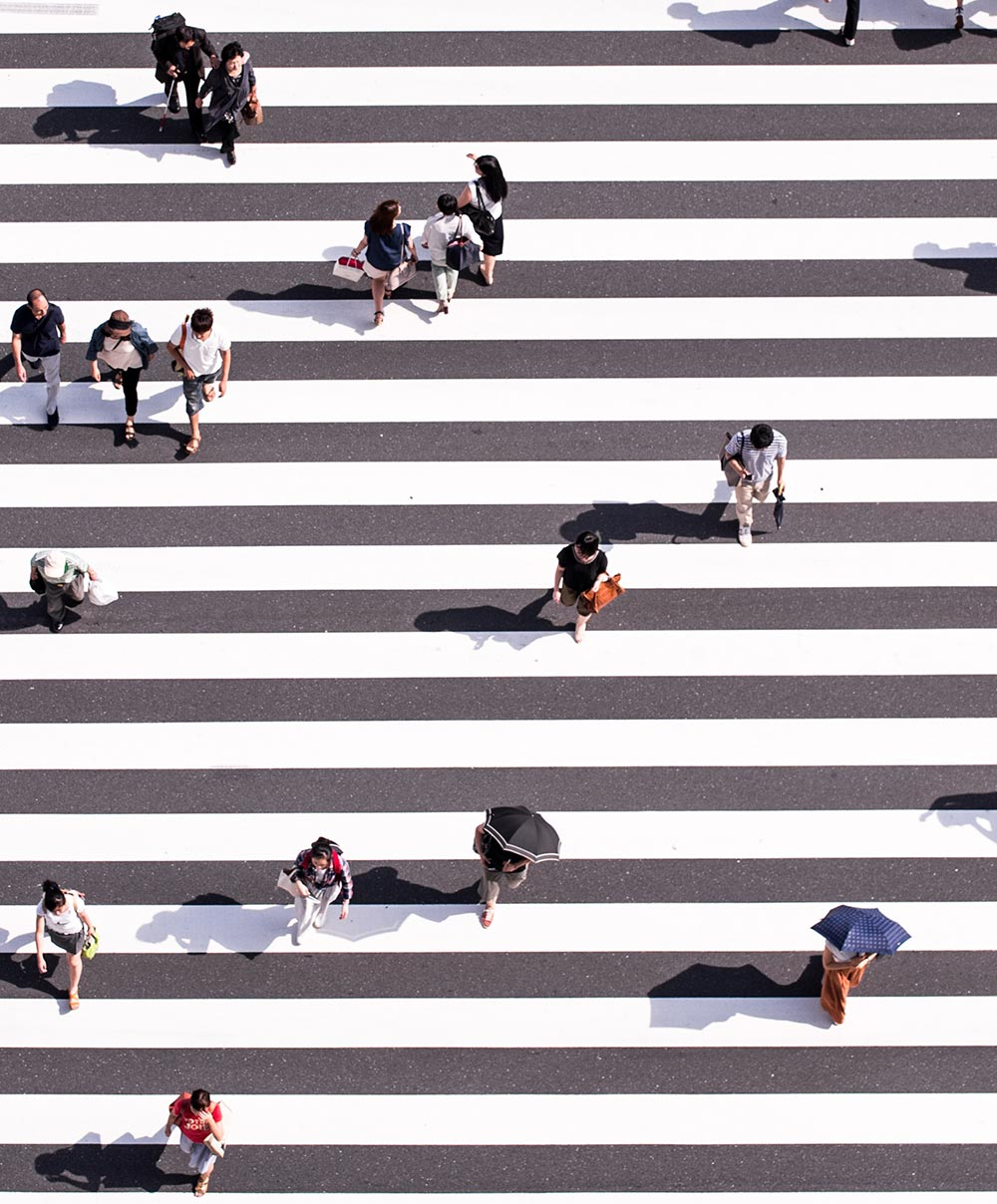 Overhead Image of People Walking on Striped Street