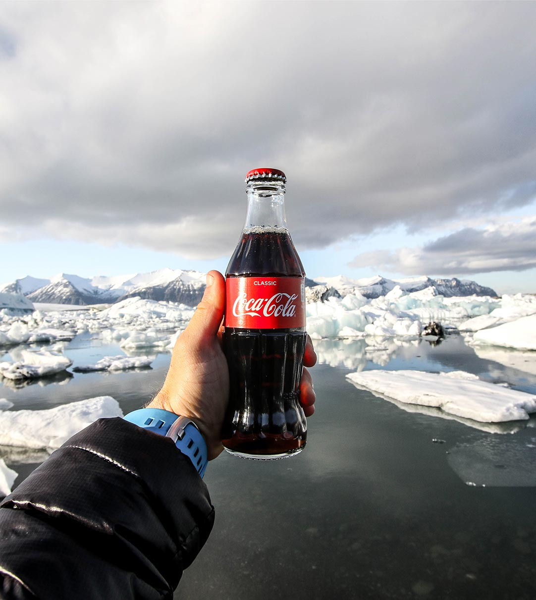 Coca-Cola bottle in front of a mountain range