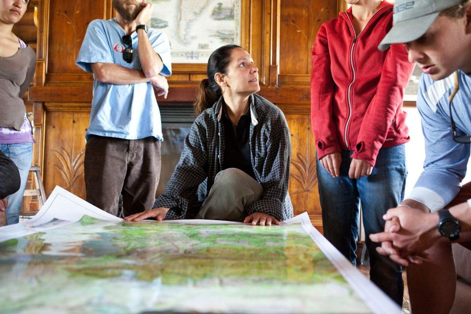 People sitting around and studying a map