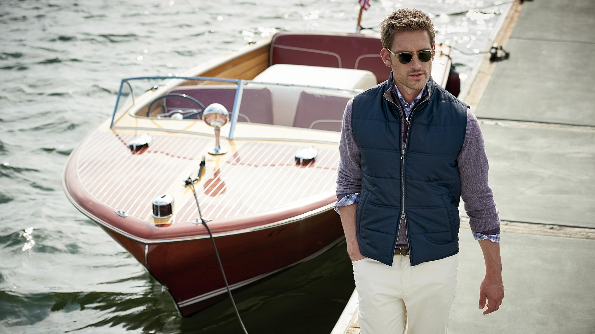 Image of Man Walking Away From Boat Wearing Peter Millar Clothing