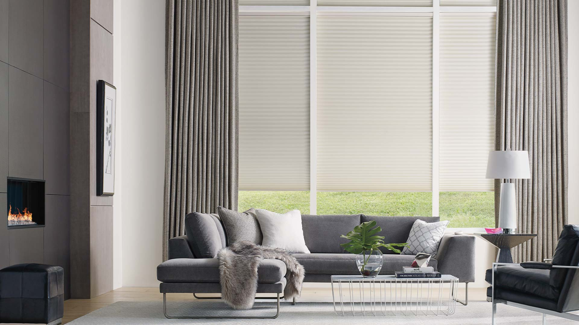 Room scene with sofa in front of windows with vertical blinds half closed