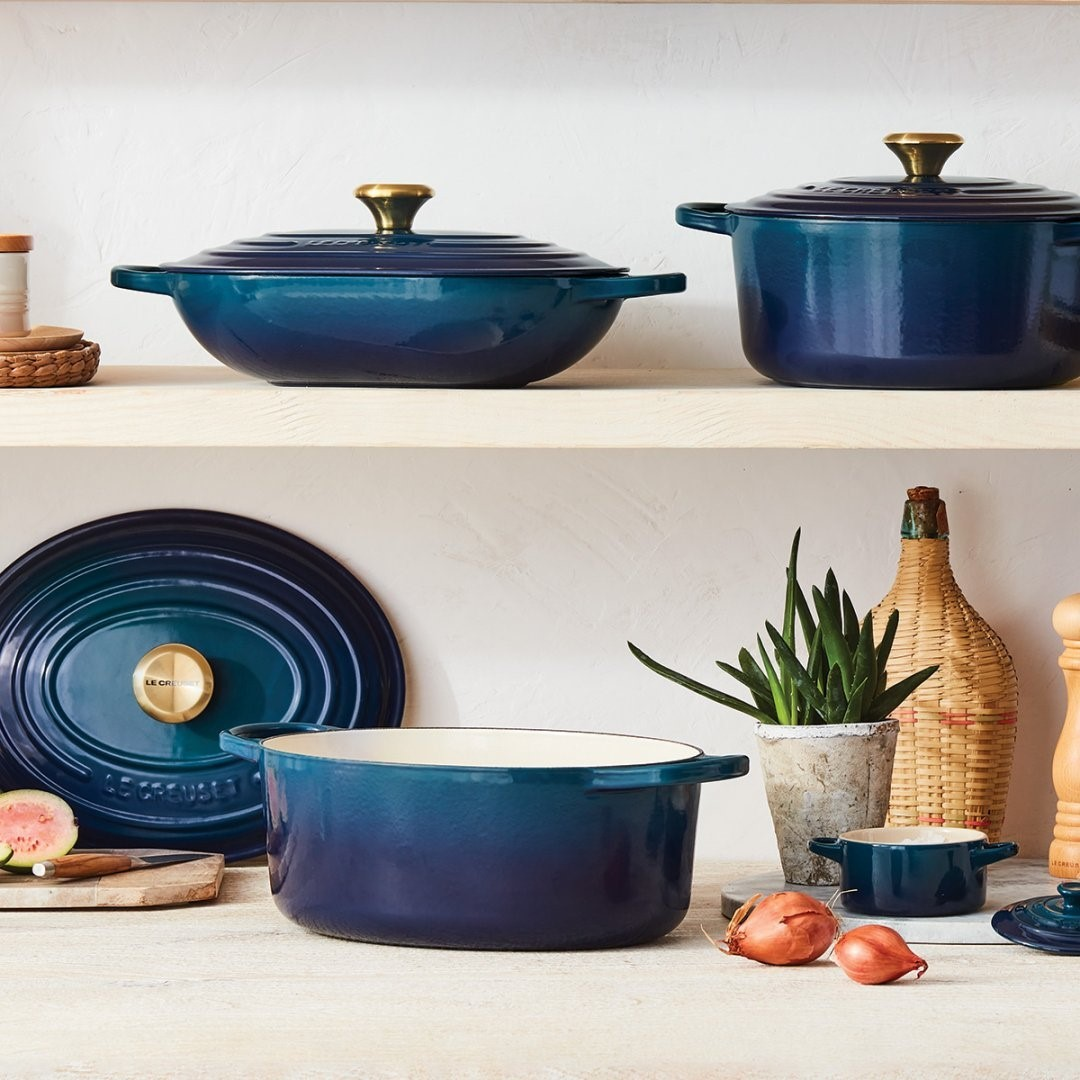 Still life shot of dutch ovens on the counter and shelf