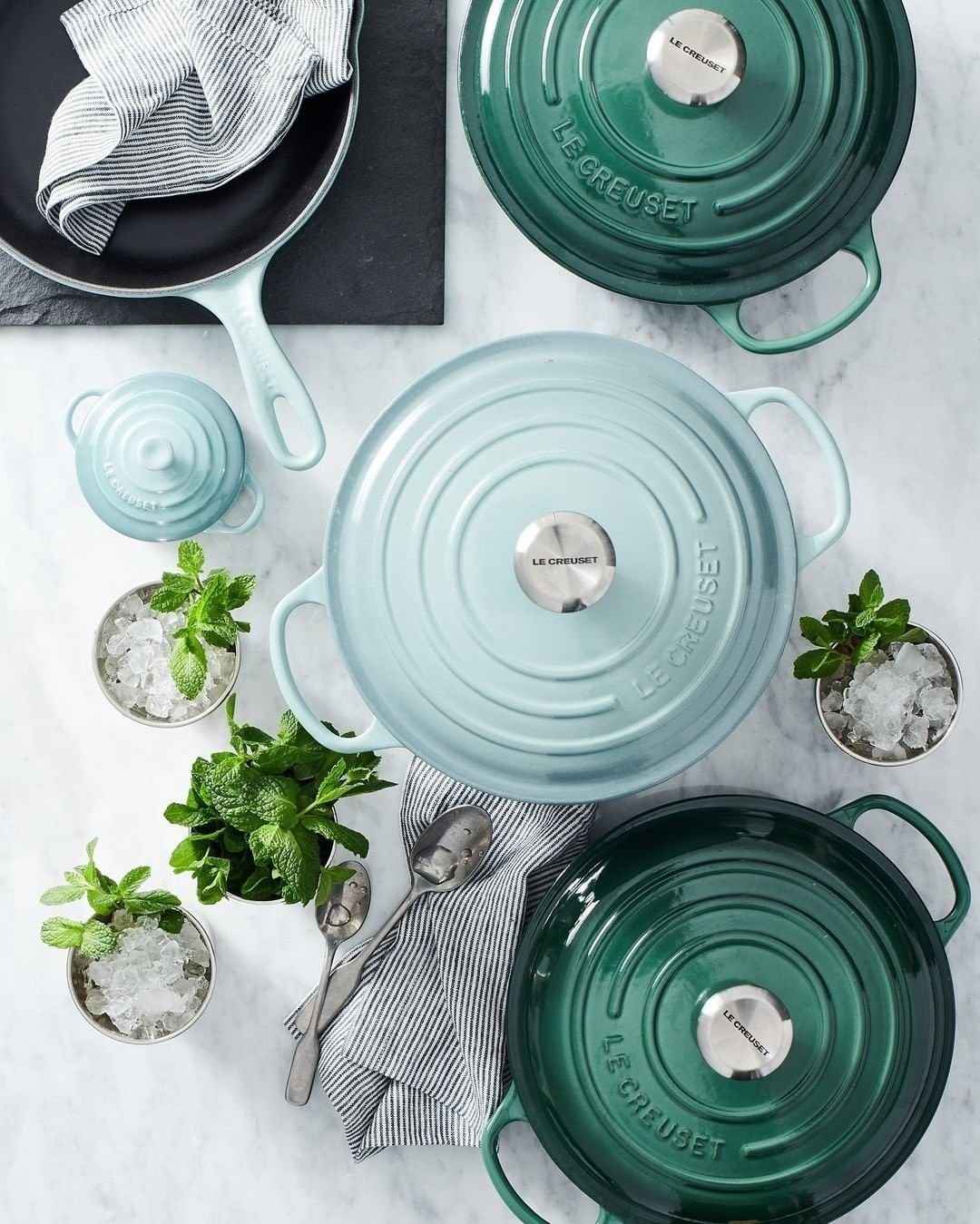 overhead shot of blue and green styled dutch ovens