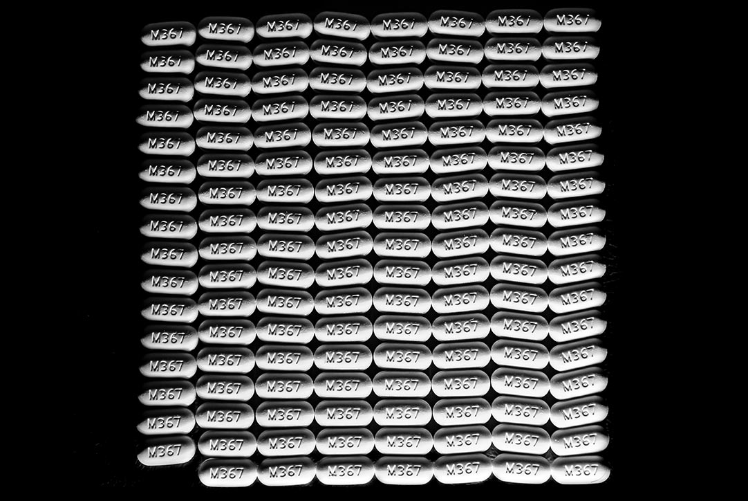 a line of pills on a black background