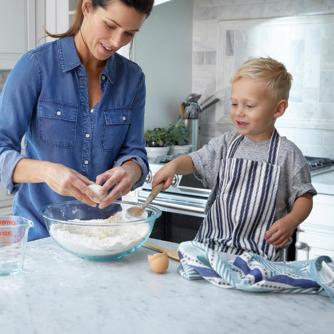 mother and child in kitchen baking