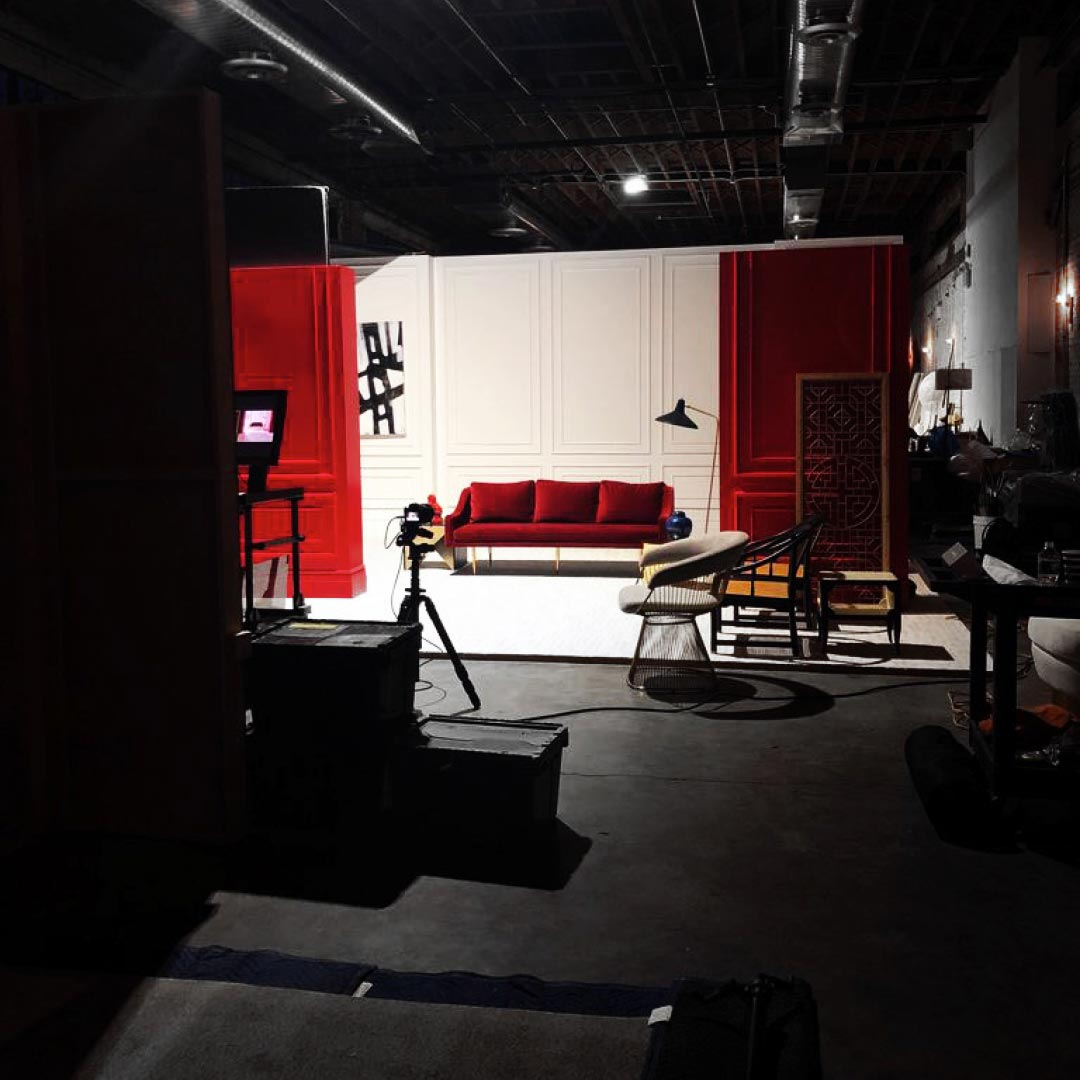 behind the scenes of photoshoot with couch in scene