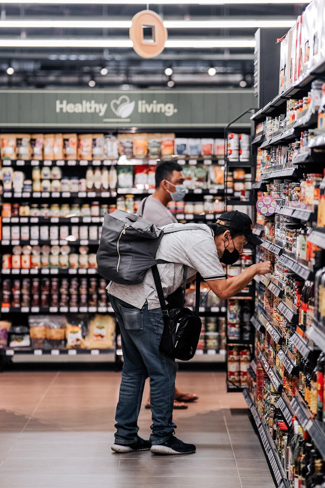 two people in aisle at grocery store