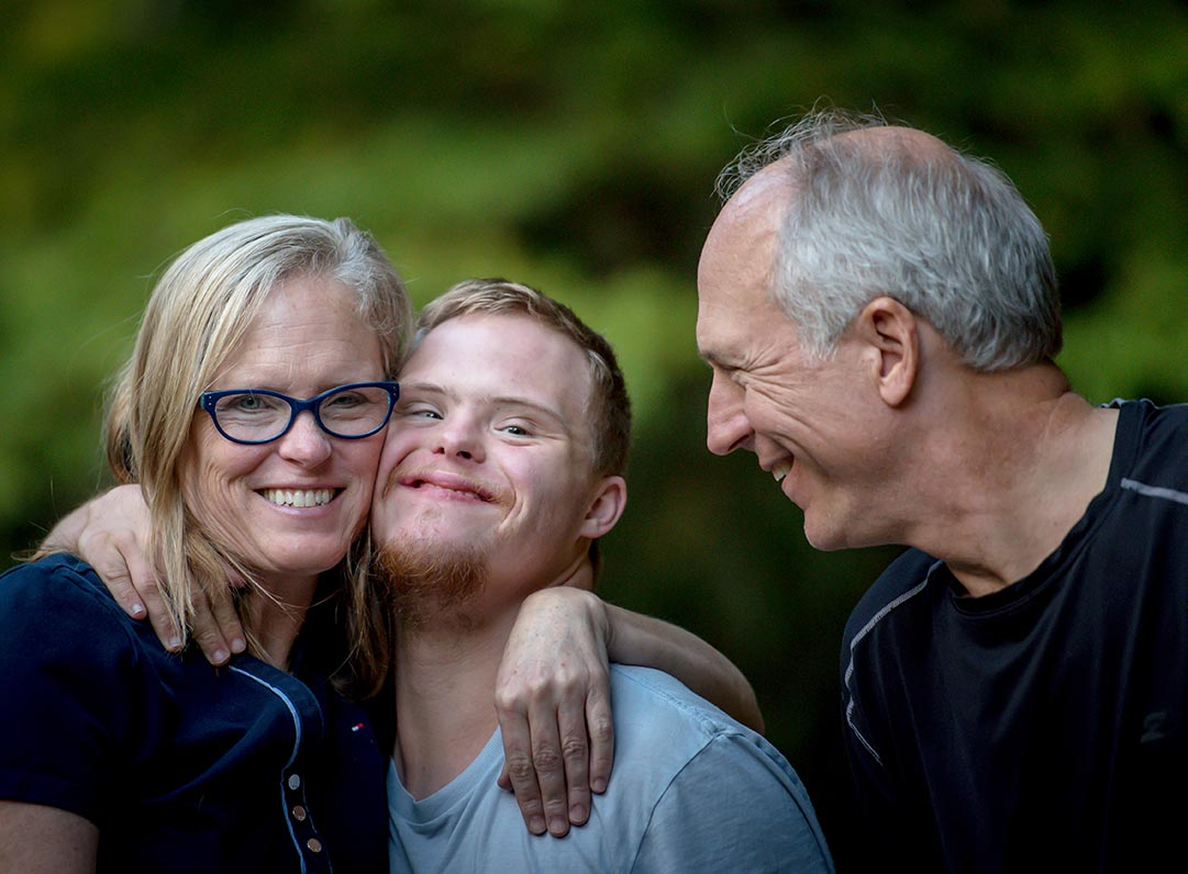 mother and father with son with down syndrome