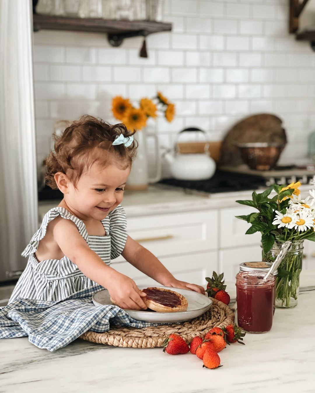 kid on counter with jam